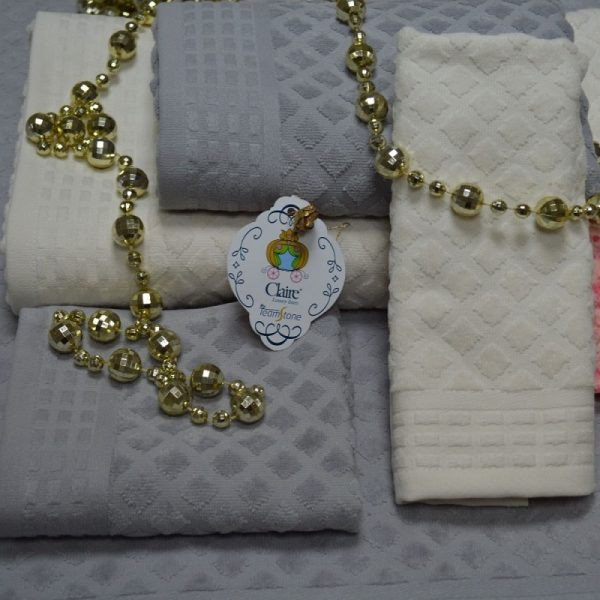 100% cotton terry bath towels with cotton ton/ton jacquard borders. Velour touch and finish.