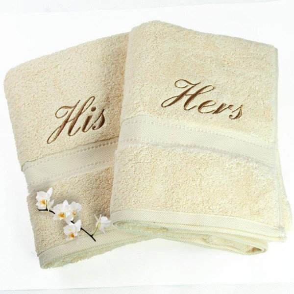 Terry bath towels in 100% cotton with ton / ton cotton jacquard border. Customized with embroideries.